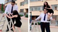 巨人帅哥2米38娇小美女只有1米55 为了一个抱需要用梯子
