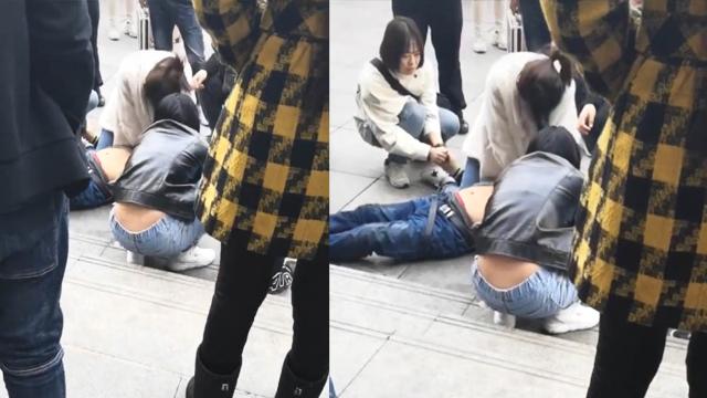 男子火车站突然倒地 多名女学生现场救人